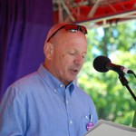 Portland Mayor Michael Brennan reads Pride proclamation to the crowd at Southern Maine's Pride Festival.  Photo credit: Chuck Colbert