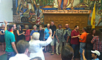 At least a dozen recipients of the county's first licenses held an impromptu mass gay wedding in the chambers of the county commission just minutes after receiving their licenses.  Photo: ProgressNow New Mexico