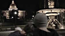Sean and Jade (homeless youth) huddle in the cold while gazing at the Massachusetts Statehouse.  Photo: John Consilvio, WIT•101 Productions
